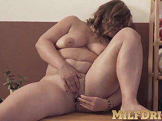 Brunette beamy MILF Diya stripping and toy wadding her pussy