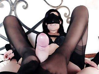 Lady Marilyn rewards her slave with a footjob together with blowjob