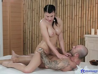 Rubbing the Perk be advisable for His Cock with Her Oiled-Up Tits
