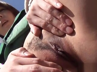 Asian spreads the brush pussy